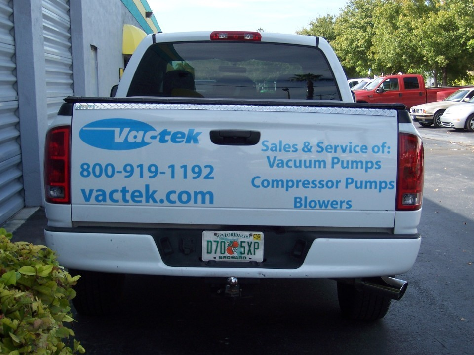 vinyl truck lettering for vactek in davie florida installed by car wrap solutions in